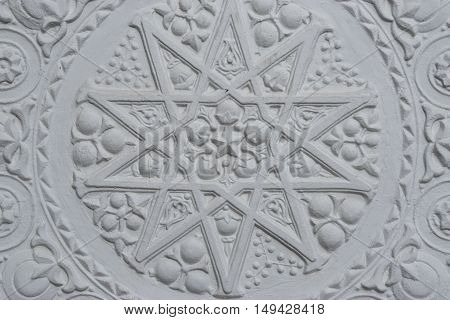 stucco on the walls and white patterns on the walls, architecture