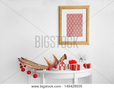 Decorated moose horn on white table