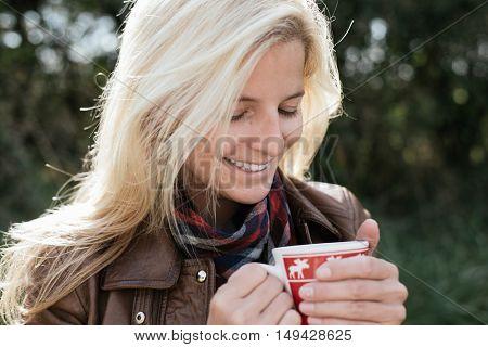 Woman drinking hot tea outdoor