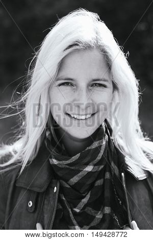 Black and white outdoor portrait of a blonde woman