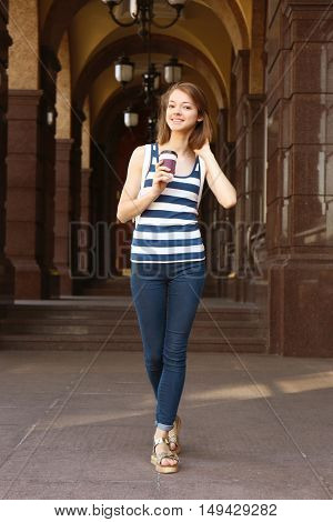 Young girl with coffee on a sunny day