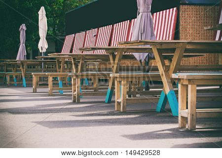 wooden tables and benches, playground at the fair