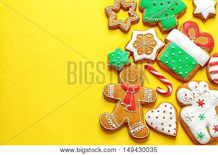 Delicious Christmas cookies on yellow background