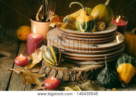 Halloween table setting with decoration, copy space