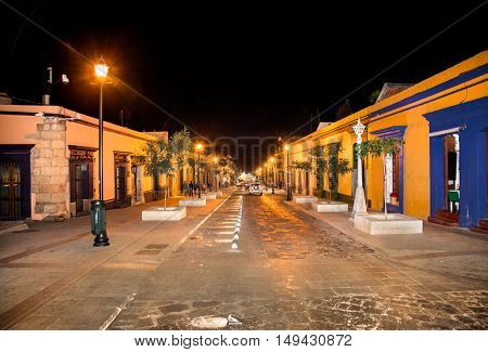 Street of Oaxaca by night, Mexico. The city architecture of Oaxaca is protected by UNESCO