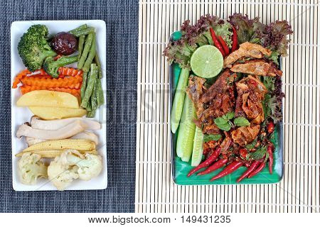 Spicy sour mixed herb salad with fried stir taro in tofu sheet served with fried  mixed vegetables for  in Vegetable festival of Chinese as