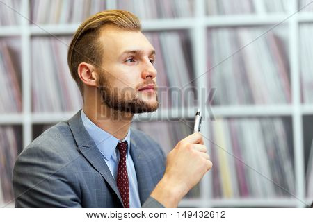 Portrait of a friendly businessman in his office