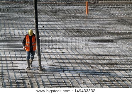 Milan Italy - January 17 2016 - Concrete casting on Reinforcing Bar of floor in industrial Construction site