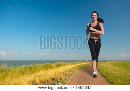 Woman Running In Summer