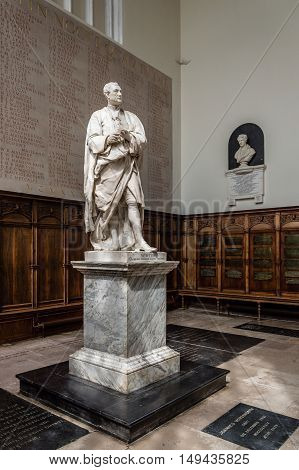 CAMBRIDGE UK - AUGUST 11 2015: Statue of Newton in Trinity College in the University of Cambridge. Cambridge is a university city and one of the top five universities in the world.