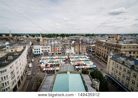CAMBRIDGE UK - AUGUST 11 2015: High angle view of the city of Cambridge with colorful stalls market.