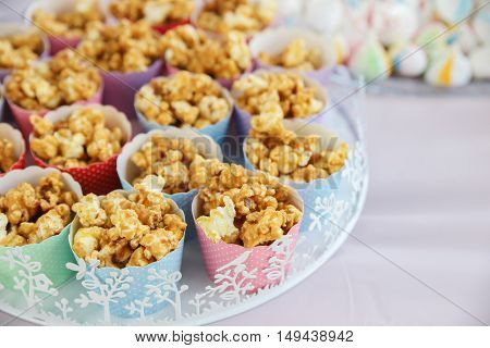 Homemade caramel popcorn in rainbow cupcake cups