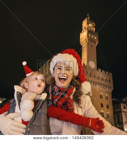 Mother And Child In Christmas Hats Having Fun Time In Florence