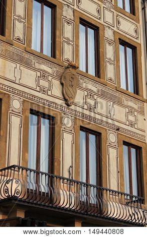 Squared windows in a renaissance palace of Florence Italy