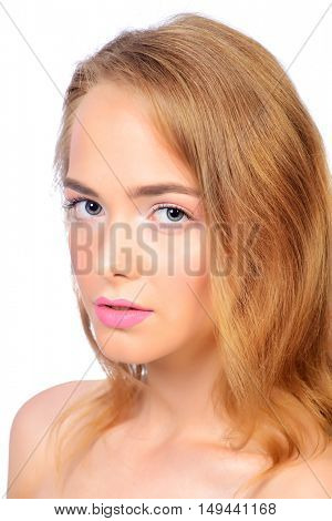 Sensual young woman with natural make-up and perfect skin. Beauty, fashion, cosmetics. Spa, body care. Isolated over white.