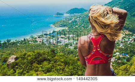 Young Beuatiful Girl is Sitting on Koh Tao Island View to Sairee Beach and Nang Yuan Island