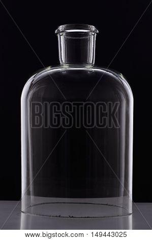 Laboratory Bottle Without A Bottom On Black Background