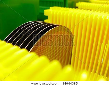 Silicone Wafer In A  Yellow Carrier