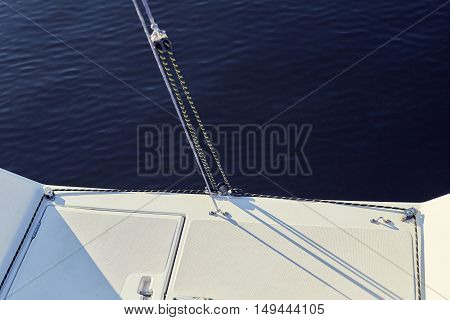 permanent backstay is attached to the top of the mast. water background