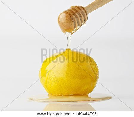 Isolate Dripping Organic Honey With Lemon On White Background