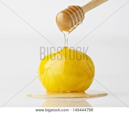 Isolate Dripping Organic Honey With Lemon On White Background