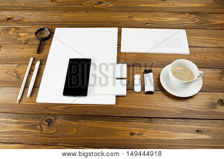 Blank stationery set on wooden background. ID template. Mockup for branding identity for designers
