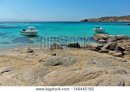 Small boat in Paranga Beach on the island of Mykonos, Cyclades, Greece
