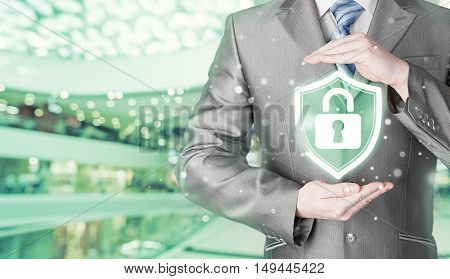Data protection and insurance. Concept of business security, safety of information from virus, crime and attack. Internet secure system. Blurred mall background.