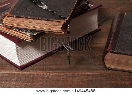Ancient books and rosary Catholic (prayer beads)