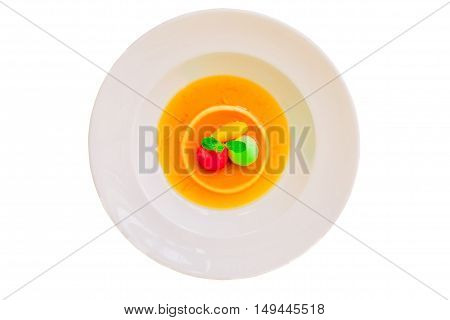 Caramel custard pudding in white plate isolated on white background. Top view.