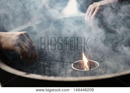 People light incense sticks for praying, Japan