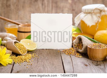 Honeycombs ,honey, Ginger, Pollen, Lemon On A Wooden Table With Empty Card For You Text