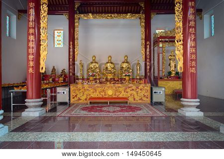 Interior Of Canton Shrine With Golden Idols On An Ornate Altar