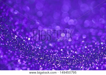 Abstract purple glitter light bokeh holiday party background