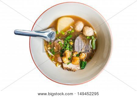 Beef noodle in traditional ceramic bowl isolated on white background. view from above