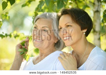 senior Mother and her nice daughter in  park