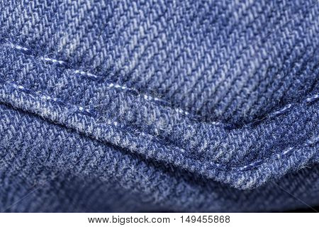 macro seam on the back pocket of blue jeans
