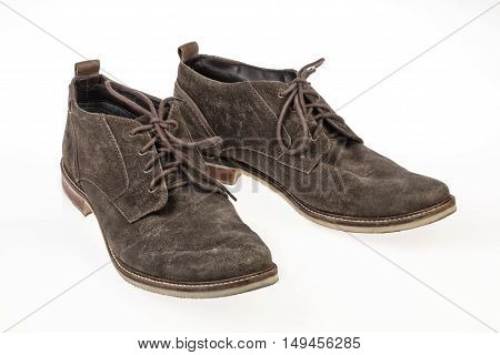 Pair of suede shoes on an isolated studio background