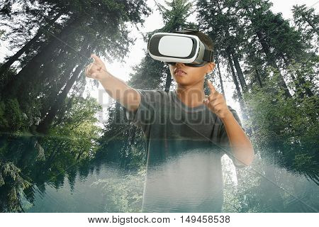 Double exposure. Afro-Amrican boy wearing virtual reality glasses and city wood background. Modern technology concept.