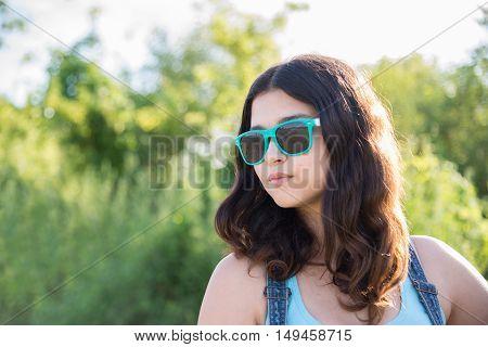 Portrait of a beautiful teen girl in sunglasses