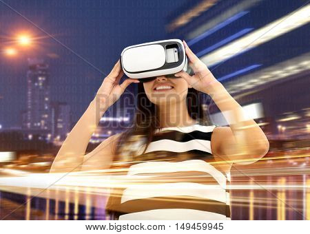 Technologies of the future concept. Young woman wearing virtual reality glasses