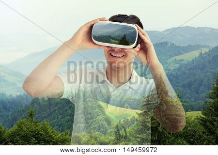 Double exposure. Young man wearing virtual reality glasses and beautiful forest background. Modern technology concept.