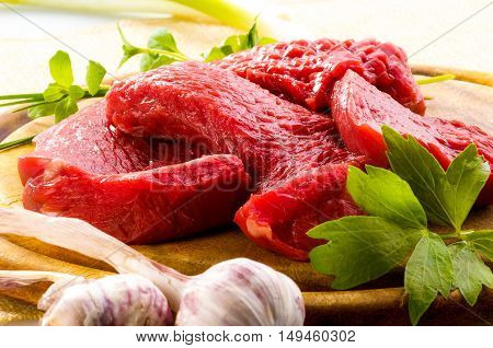 Raw beef meat on a cutting board