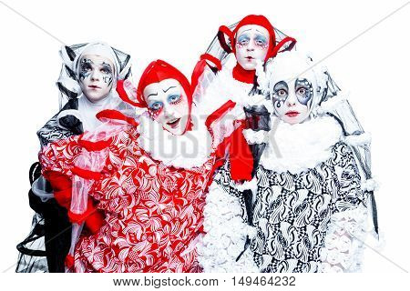 Four cheerful clown in a vintage style with a typical makeup on white background