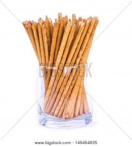 Salty sticks standing in a glass isolated. Sticks in a glass. Crunchy snack.