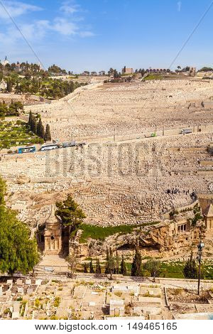 Mount of Olives and the old Jewish cemetery in Jerusalem, Israel. Benei Hezir Tomb and Absalom's Tomb foreground.