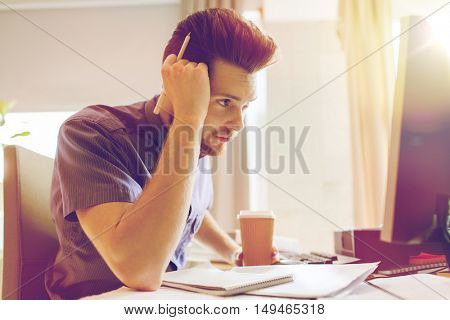 business, startup and people concept - businessman or creative male office worker drinking coffee and thinking
