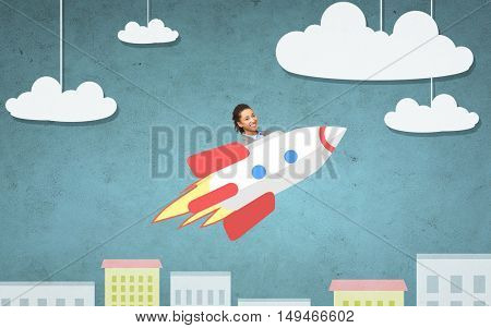 business, startup, development and people concept - businesswoman flying on rocket above cartoon city