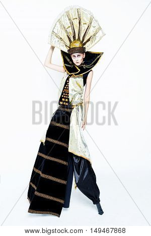 Beautiful Golden Venetian Carnival Masked woman, sun costume on white background