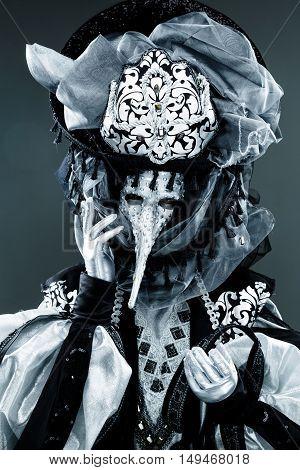 Portrait of Beautiful black an white Venetian Carnival Masked man